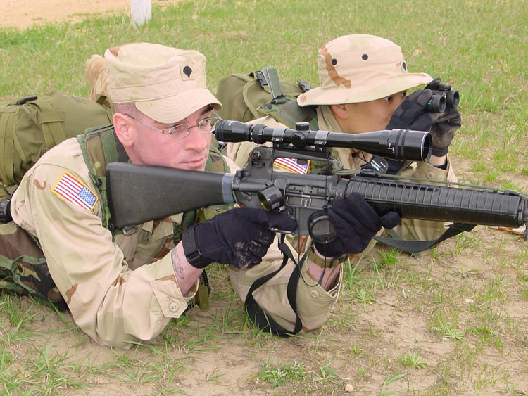 Iraq War Photo. Fitz (Fitzgibbon) was the infantry man of our platoon. Here, he's testing out his sniper scope on his M16 while I play spotter alongside him.