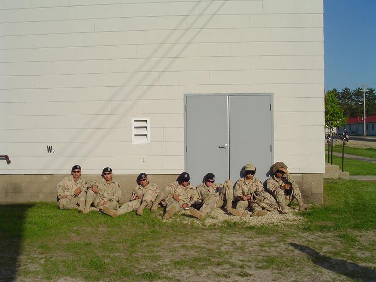 Iraq War Photo. Relaxing against the wall before we get the word to embark.