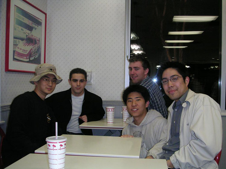 Iraq War Photo. I went home on leave on February 04, exactly one year after my deployment orders. Here I am, with my closest friends. The man sitting next to me is Sean Novak, followed by Matt McKinney, Sung Nam, and David Uyan.