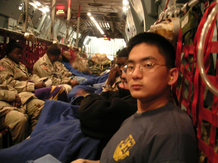 Iraq War Photo. I should have known better... I thought we were going to fly in commercial airliner, back to the hottest continent on earth. I was wrong. I don't know if you can tell, but I'm flying across the Atlantic Ocean in a C-141, wearing 4 T shirts because I didn't think it'd ever get cold enough.