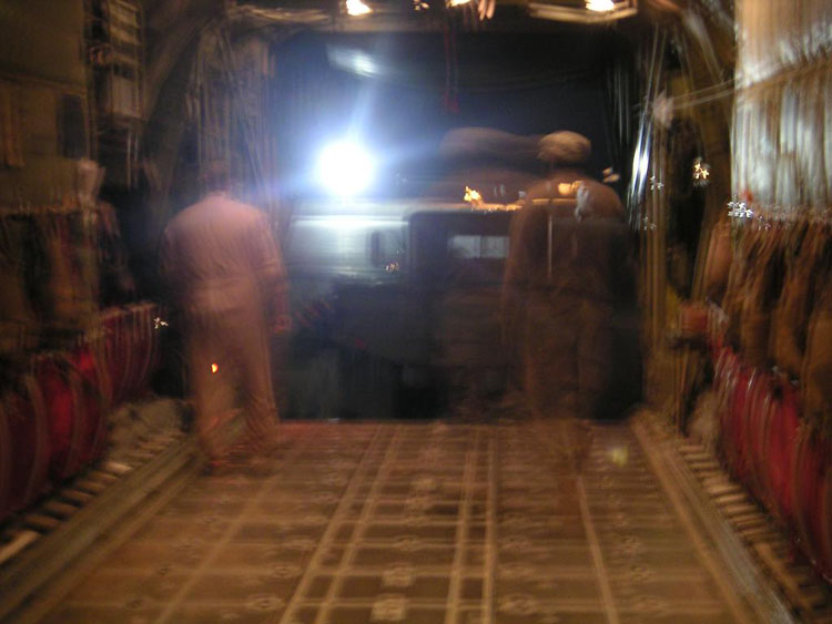Iraq War Photo. I would get in a C-130 to fly to Djibouti. But that's not before they put an entire truck in the plane to take off with.