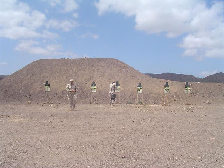 Iraq War Photo. Contreras returning from his target, and Fitz keeps lighting them up. Contreras was the best machine gunner I'll ever meet, and Fitz was an expert marksman, consistently shooting over 36 of 40 targets ranging from 50 to 300 meters with iron sights.