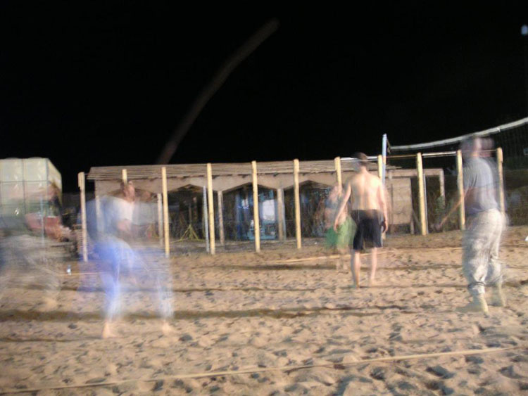 Iraq War Photo. Drunken volleyball. The night was dark enough that the camera automatically went into longer exposure shots. I think it ended up being better that way. Everyone had to swear to have drank 6 bottles of beer minimum, with several of us having a lot more than that. This particular evening, though, I was too tired to take part in the game and decided to take a sit and take pictures of the times I knew I was going to miss.