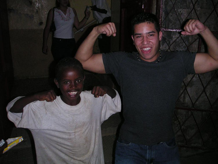 Iraq War Photo. We went out as often as we could, probably averaging around once a week or so. Here Sanchez plays around with a Djiboutian kid. They didn't understand us for the most part.