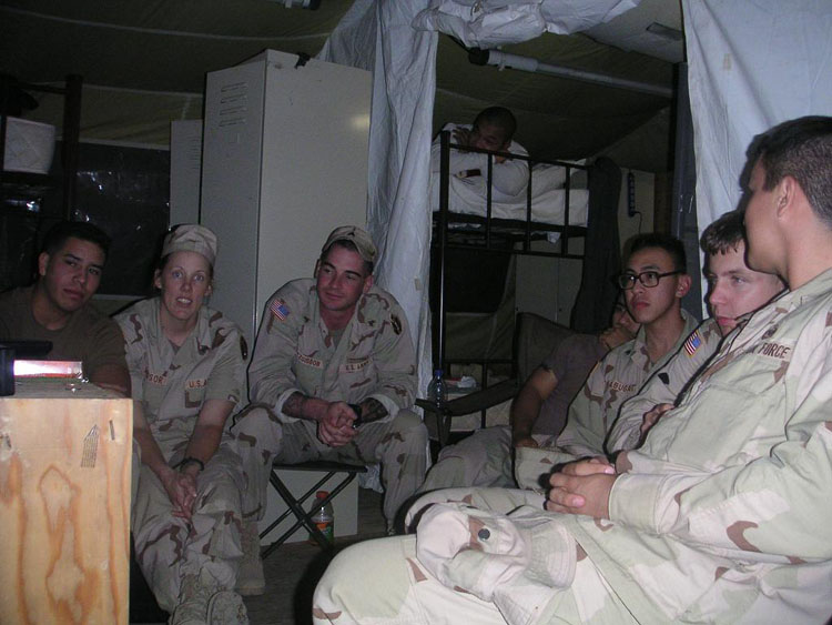 "Iraq War Photo. This is a sight to behold. How many of us are there? You're correct if you said that there are 9 of us watching a single 27"" TV on a wooden TV stand that I set up. There's 3 on the left, 1 on the bed on top, 4 to the right, and me on the bed, close to the TV to take this group shot of us watching a Japanese Anime called Initial D."