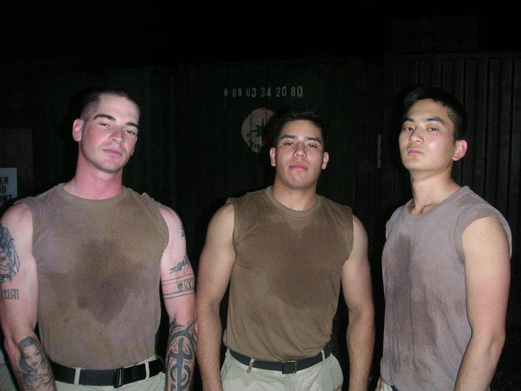 Iraq War Photo. Fitz, Sanchez and me, tired after working all day, drinking all night, and kicking ass in drunken volleyball.
