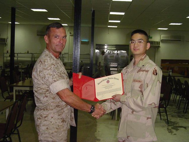 Iraq War Photo. This is the proudest moment of my deployment. Out of everyone in Camp Lemonier, I was awarded Soldier of the Quarter.  Certificate of Commendation Commanding Officer U.S. Marine Forces Central Command - DJibouti takes pleasure in commending Specialist Sung Kim United States Army  for  Superior Performance of duties while serving as the Army Service Member of the Quarter for U.S. Marine Forces Central Command, Camp Lemonier, Djibouti, Africa, during the Second Quarter Calendar Year 2004. Specialist Kim demonstrated those traits and qualities that clearly distinguish soldiers of an exceptional caliber. Specialist Kim's military bearing, knowledge, and command presence were unmistakably evident in his daily activities and before the MARCENT Headquarters Service Member of the Quarter Board. Specialist Kim's professional manners, initiative and proactive attitude reflected great credit upon himself and were in keeping with the highest traditions of the Marine Corps and the united States Naval Service. Congratulations on a job well done!  23 March 2004  W.H. Callahan Colonel U. S. Marine Corps Commanding