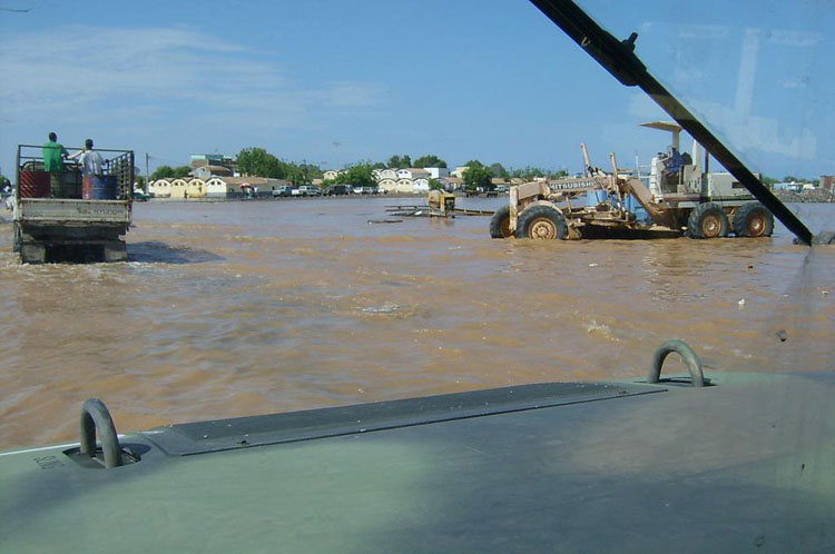 Iraq War Photo. People don't realize that it doesn't rain much in Africa, but when it does, it devastates the cities. The rural areas are even worse. We filled up 87 body bags.