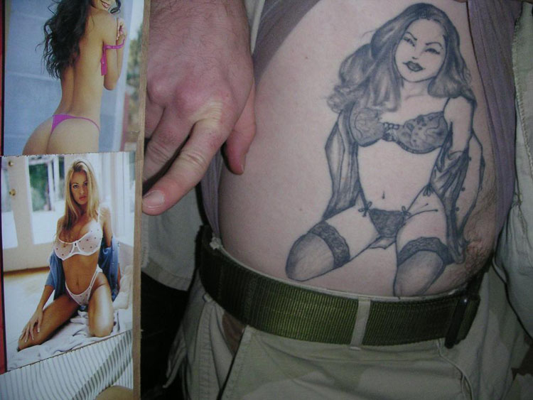 Iraq War Photo. We're now in Kuwait. Fitz found a picture on SGT Lopez's wall of playboy daily calendar playmates that resembled the tattoo on his stomach. He was so excited, we went back to get our camera so we can take this picture for him.
