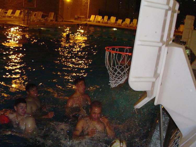 Iraq War Photo. Here we are, playing water basketball. It required no dribbling skills, so that meant I could play. No matter how hard we tried,though, all of us would walk out of the water with scratch marks.