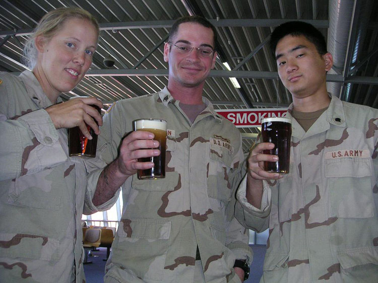 Iraq War Photo. We're in Ireland. Because of their 18+ drinking policy in the airport, command allowed us to have one drink of Guinness draft. I was 20. But that doesn't mean they didn't give me a hard time about it. A lot of people ask me, how hot was it in Kuwait and Djibouti? Well, we flew commercial airline with cushioned seats but we still had to load our own equipment into the belly of the plane. I had a few moments where I had to stand directly behind the jet exhaust in the back of the plane. I would say that would come very close to how hot it is out there, but just all day, everyday.