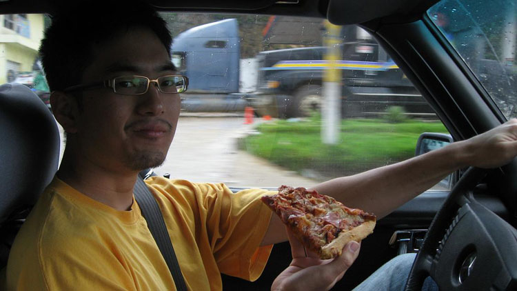 Drive to Guatemala Photo. I am having pizza for lunch that I bought off one of the guys at a speed bump (called tumulos in Guatemala, tope in Mexico).  This proved to be a great move because...