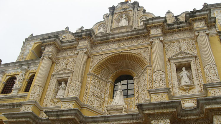 Drive to Guatemala Photo. The Santa Catalina Church in Antigua.  Very distinct colors and design, especially compared to the indigenous cathedrals in Chichicastenango.