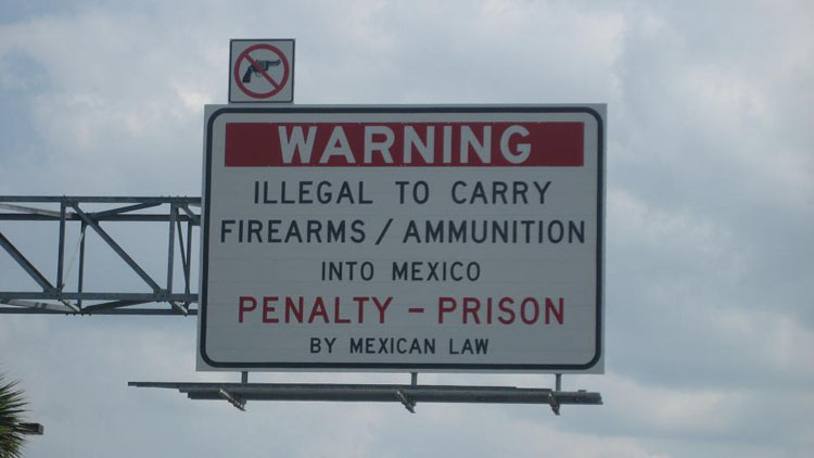 Drive to Mexico Photo. This is on the Texas side of the Mexico-America border, in Laredo.  Guns are illegal for citizens of Mexico, not just visitors.  I bought my vehicle license for Mexico in this city.