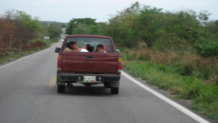 Drive to South America Photo. Here is a simple photo in Mexico that I took just to start things off. I thought that seeing people riding in the back of pickup trucks would be a rarity, but it really wasn't. People use them all the time as mini buses or taxis.