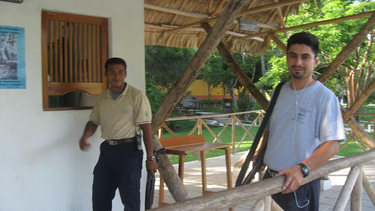 Drive to South America Photo. Flashing weapons of destruction isn't a rare thing in Latin America. There are several police as well as military checkpoints, more in some countries than others. Here, a couple security guards bring out their shotguns for the photo shoot in Tikal, Guatemala.