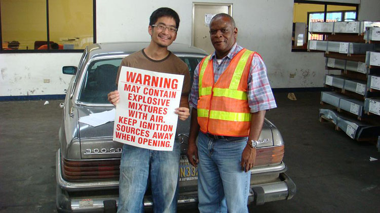 Drive to Panama Photo. Because my car was shipping with gas still in the tank, I had to buy this sign to post on the container.  Edmond is in charge of handling containers in Cristobal (port right next to Colon, Panama).  He spoke great English, having studied it at a university level.