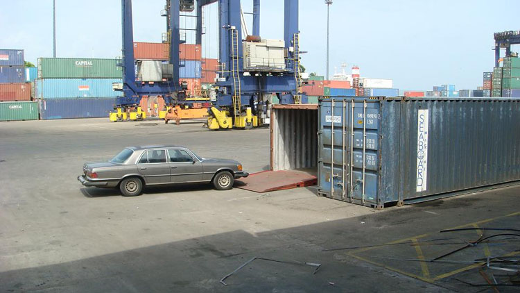 Drive to Panama Photo. The guy is trying to get my car lined up to go up the ramp into my assigned container.  The container would be loaded into a Seaboard Marine vessel named Polaris.