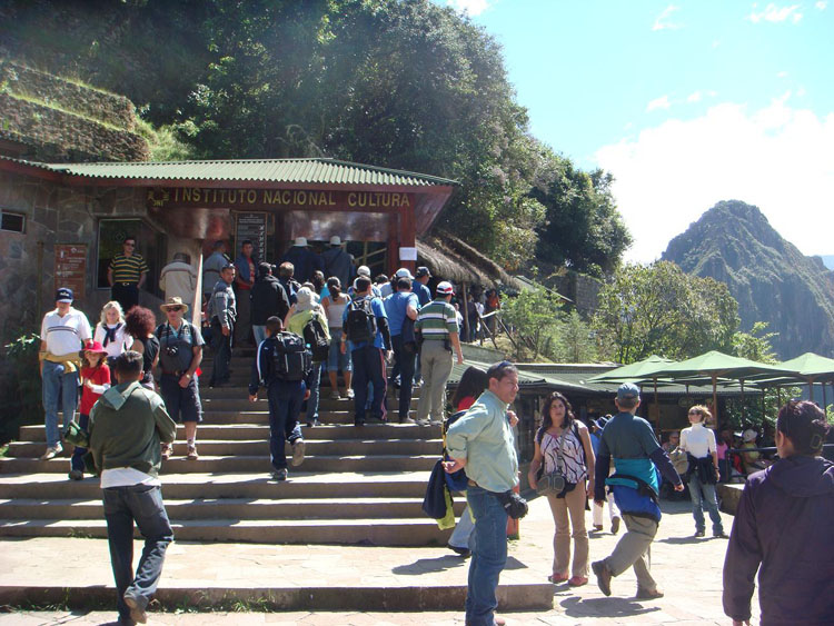 Drive to Peru Photo. Then there's another 25 minute bus ride up the steep mountain to the entrance of Machu Picchu. This is what the ticket booth looks like. You must buy your tickets ahead of time, they simply collect your tickets here.