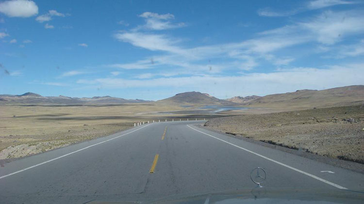 Drive to Peru Photo. Desolate, barren, nauseating. This picture was taken during the course of the last post, but I decided to include it anyway. Ever wonder what driving at 15000 feet looks like? I never did, but I got to find out. (Ok, ok, so it was 14938 Feet) I had to pay toll at 13000 feet. I had the accelerator pressed halfway down and it still had trouble keeping itself going.