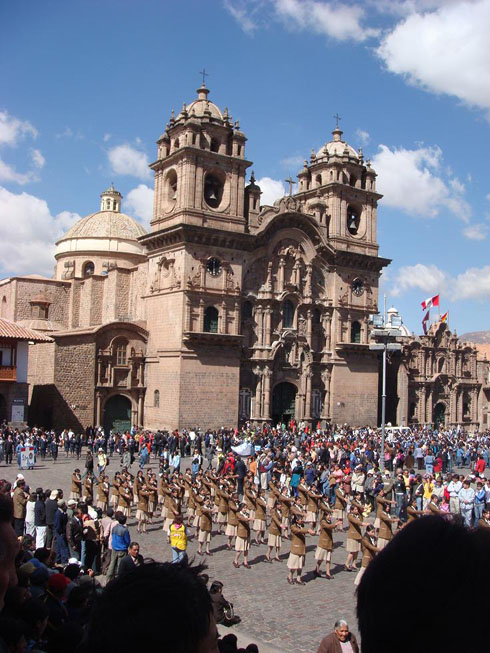 "Drive to Peru Photo. ""I went immediately then to Plaza de las Armas, where I could hear some music being played. It was the military band playing as a parade went marching by the Plaza, in front of the main Cathedral. This went on as the band kept playing the same song for about an hour or so."" It was actually somewhat freaky. The marching was reminiscent of communists' military parades, with young girls attempting to march in step while kicking high and exaggerating arm movements."