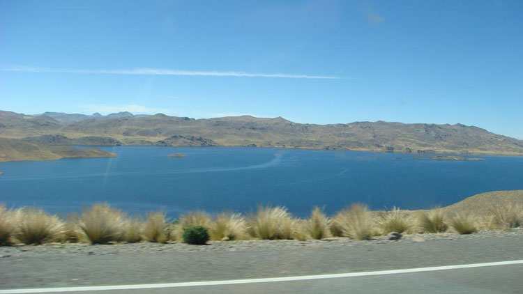Drive to Peru Photo. The answer is 13000 feet. This one is at 14000. The lake is high enough that it's too cold to evaporate and low enough that it's not iced. In fact, there is a bridge that you have to take to go across it. That was a pretty cool experience, all at 14000 feet.