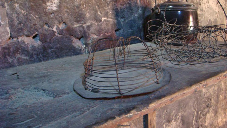 Drive to Peru Photo. Rat trap. The rat would reach for the food inside. The wires hanging down in the middle would trap the mouse and prevent it from moving back out. The nuns would not kill the rats and would simply let it sit there and die.