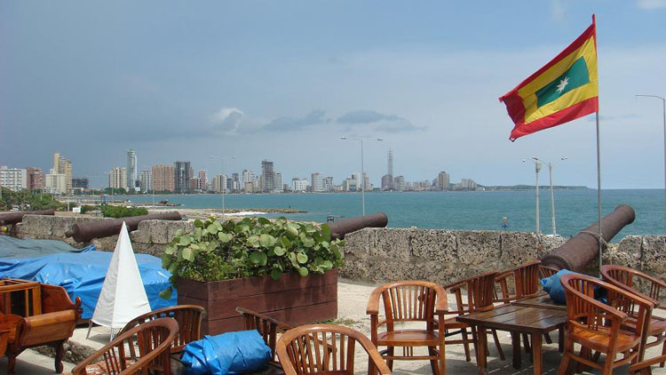 Drive to Colombia Photo. On top of a wall, this time facing the hotel resorts that run down the bay called Bocagrande.
