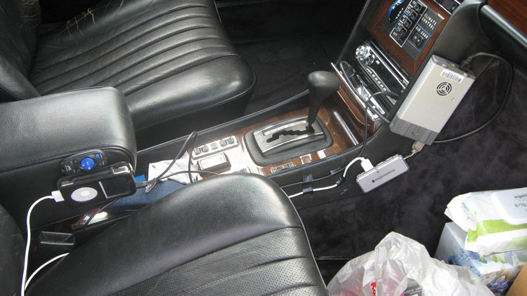 My car rig. Electrical tapes around the iPod USB adapter and audio adapter. The AC cigarette power inverter and the iPod on the side is attached via Velcro. Listening to 80GB worth of music on my iPod via car stereo. Got another 30 GB one waiting. So far 112, 311, 3 Doors Down, and 50 Cent discographies listened to. Right now listening to: A Perfect Circle.